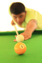 Playing pool thai young man Stock Photo