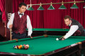 Playing pool two confident young men Stock Image