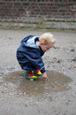 Playing in a puddle Royalty Free Stock Photo