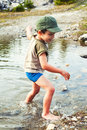 Playing in river water boy a mountain during summer Royalty Free Stock Image