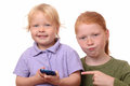 Playing with a smartphone two kids new Royalty Free Stock Image