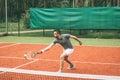 Playing tennis.