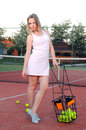 Playing tennis woman on the court Royalty Free Stock Photo