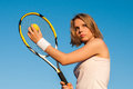Playing tennis woman on the court Royalty Free Stock Image