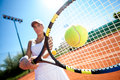 Playing tennis young woman on a sunny day Stock Image