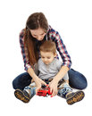 Playing with toy car mother and son a sitting on floor Stock Photo