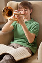 Playing the trumpet at home Royalty Free Stock Photo