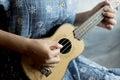 Playing ukulele Royalty Free Stock Photo