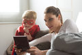 Playing videogames together mother and superhero child in the living room Royalty Free Stock Photos