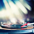 Playing vinyl record spinning on dj turntable Royalty Free Stock Image