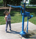 Playing at the Water Pump Royalty Free Stock Photo