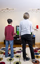 Playing the Wii Video Game System Stock Photography