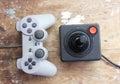 Playstation joystick with vintage joystick Royalty Free Stock Photo