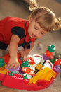 Playtime baby girl playing with her colourful music toy Royalty Free Stock Photography
