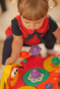 Playtime baby girl playing with her colourful music toy Royalty Free Stock Photos