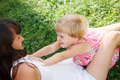 Playtime young women and little girl having good time outdoors Stock Photos