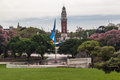 Plaza san martin buenos aires the beautiful an argentinian flag and the englishmen clock tower blooming trees frame the flag and Royalty Free Stock Photos