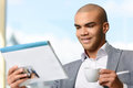 Pleasant businessman drinking coffee Royalty Free Stock Photo