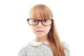Pleasant little girl wearing glasses what a wonder close up of nice in showing surprise and looking straight while standing Stock Image