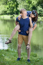 Pleasant moments by the lake couple having Stock Image