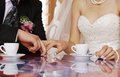 Pleasant pastime behind a coffee cup groom and the bride drink Royalty Free Stock Images