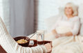 Pleasant woman holding tray with breakfast Royalty Free Stock Photo