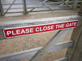 Please close the gate sign Royalty Free Stock Photo
