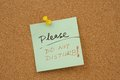 Please do not disturb words written on paper and pinned on corkboard Royalty Free Stock Photography