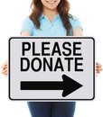Please donate a woman holding a sign indicating Royalty Free Stock Photo