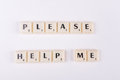 "Please help me isolated photo of scrabble letters saying ""please Royalty Free Stock Photos"
