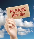 Please hire me brown card is holden by woman hand with blue sky and white clouds background Stock Images