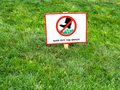 Please keep off the grass sign attention Royalty Free Stock Photo
