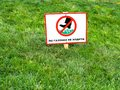Please keep off the grass sign in ukrainian language. Royalty Free Stock Photo