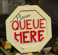Please Queue Here Sign Royalty Free Stock Photo