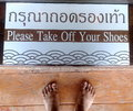 Please take off your shoes Royalty Free Stock Photo