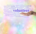 Please volunteer bokeh background male hand palm up with the word floating above surrounded by relevant words on a rainbow colored Royalty Free Stock Image