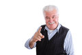 Pleased senior man talking and pointing handsome male pensioner in vest with mustache on isolated background conversing finger Royalty Free Stock Photo