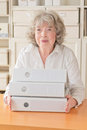 Pleased woman with files folders elderly lady copyspace Royalty Free Stock Photos
