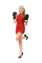 Pleasing blond young woman in boxing gloves Stock Image