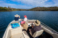 Pleasure boat cruise waters fun on dam lake for two ladies and male skipper Stock Photography