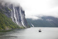 Pleasure boat in Geiranger Fjord Royalty Free Stock Photo