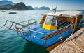 Pleasure boat with glass bottom floats moored in adriatic sea water petrovac montenegro Stock Images