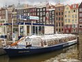 Pleasure boat near the pier in amsterdam netherlands february Royalty Free Stock Images