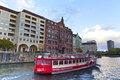 Pleasure boat on the river spree in central berlin building banks of also a sightseeing germany november Stock Image