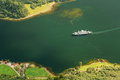 Pleasure boat ship are sailing between fjords. Amazing nature of Royalty Free Stock Photo