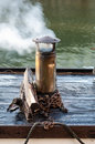 Pleasure craft chimney the of a smokes in early morning sun Stock Photo