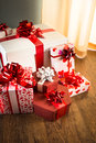 Plenty of gifts elegant christmas on hardwood floor in white and red tones Royalty Free Stock Photo