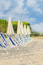Plenty of sun loungers on the beach Stock Photography