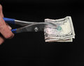 Pliers and money strong on a black background Stock Photography