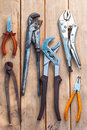 Pliers over wooden board Royalty Free Stock Photos